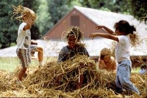 children-playing-in-straw